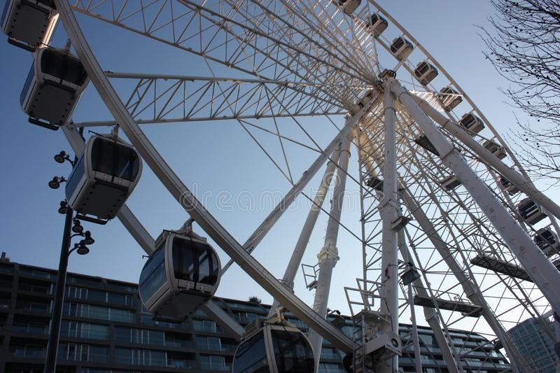 Playground. ferris wheel in the market square of Rotterdam. carousel seen from below. high student structure for tourists and stock photos