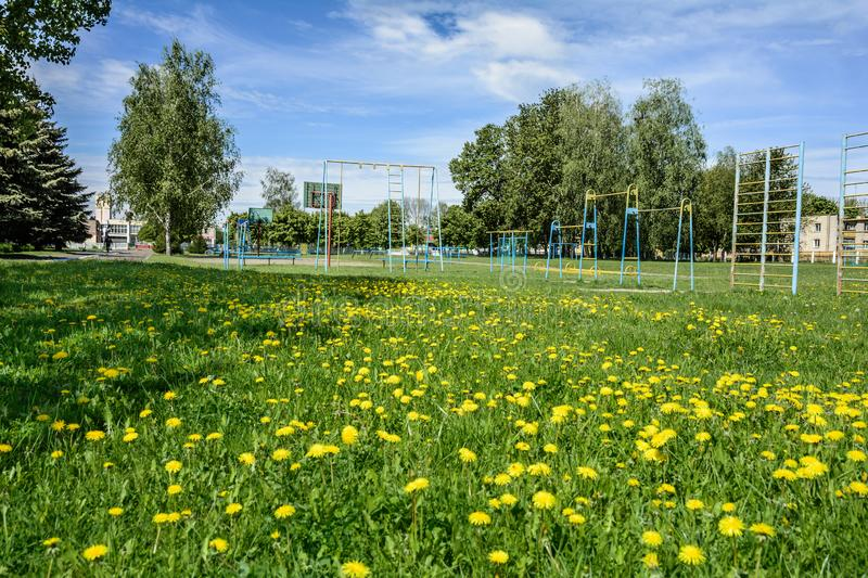 Playground for children and teenagers in the village. Playground with inventory for children and adolescents in rural areas stock photography