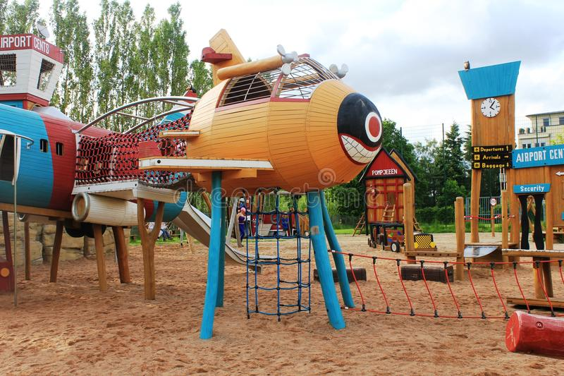 Playground for kids in Cents. In Luxembourg. Made of wood. Fun for kids all age. In the city area next to the blocks of houses and apartments. Planes and stock photos