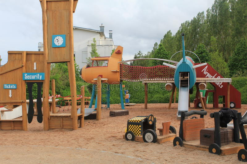 Playground for kids in Cents. In Luxembourg. Made of wood. Fun for kids all age. In the city area next to the blocks of houses and apartments. Planes and stock images