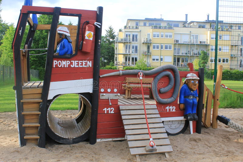 Playground for kids in Cents. In Luxembourg. Made of wood. Fun for kids all age. Fire brigade car with firemen. In the city area next to the blocks of houses stock photo