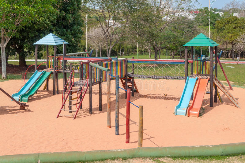 Playground for kids with many slides, swings, toys for play. royalty free stock photo