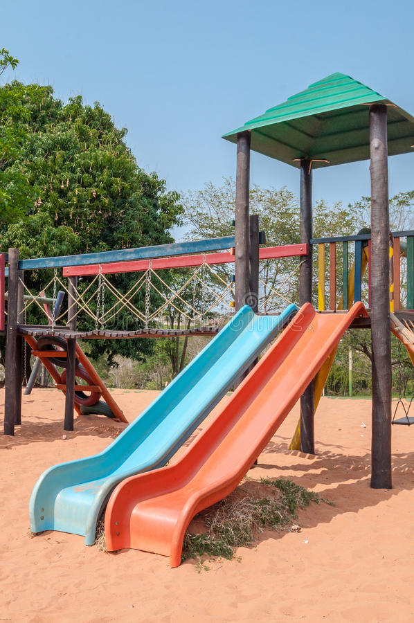 Playground for kids with many slides, swings, toys for play. royalty free stock photos