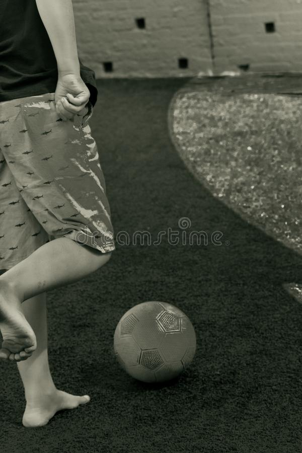 Kicking a soccer ball royalty free stock photography