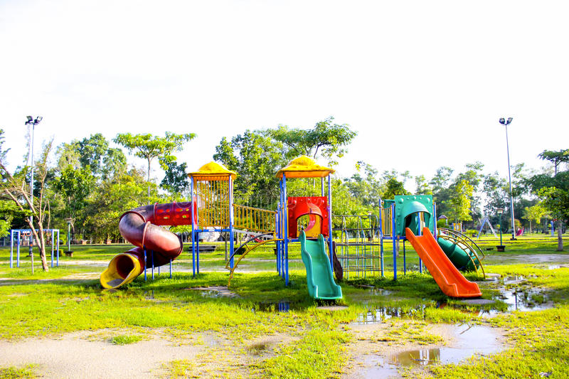 Download Playground Park On Grass Near School Is Children Stock Photo - Image of cheerful, park: 35826622