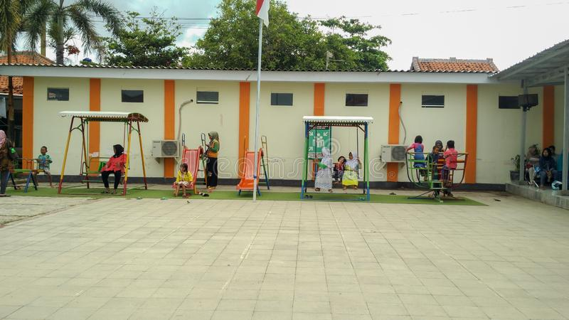 Playground in public area, childrens in sunny summer holiday. stock image