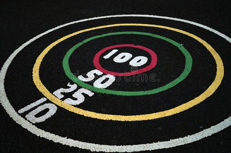 Playground`s cirlce that is differently coloured with numbers in between. Playground`s circle game that each line is differently coloured and has numbers in royalty free stock photography