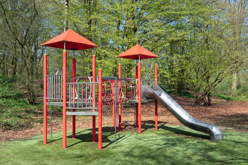 Playground with with slide in park Lelystad, The Netherlands. Playground with with slide in city park Lelystad, The Netherlands stock image