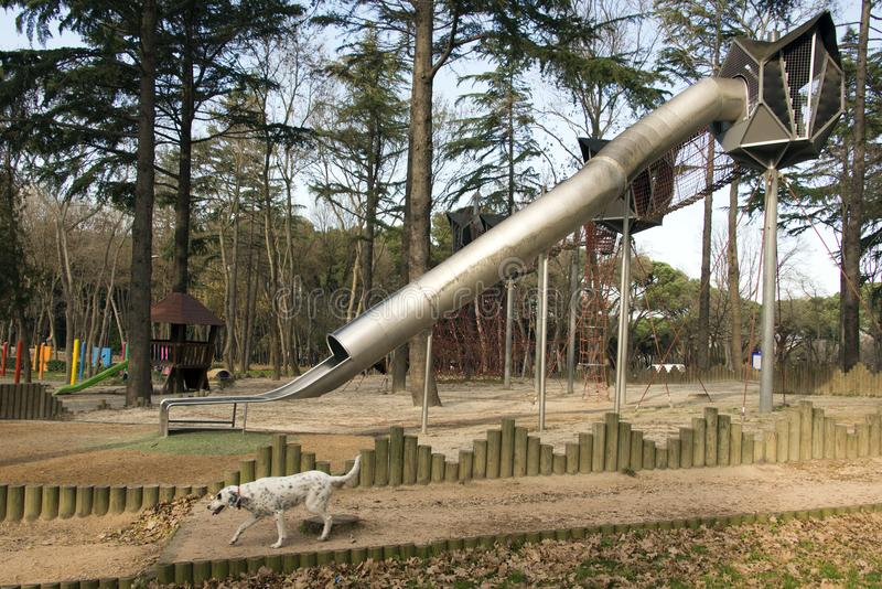 A playground and a slider and a dog playing in the beautiful park in Istanbul stock photos