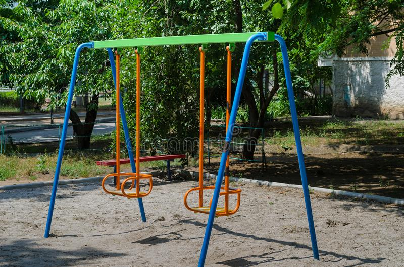 Playground on which children will find a bright rocker. Many bright colors make her joyful and attractive, so that the child wants. And for the parents in the stock photography