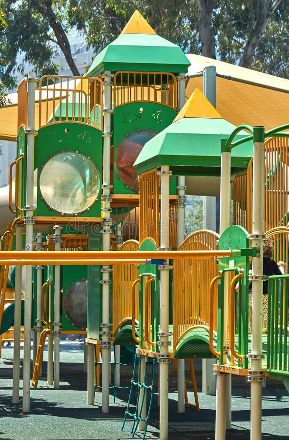 Playground yellow green, shot on a bright sunny day royalty free stock photo
