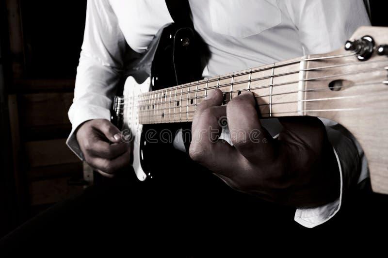 Playimg de guitare photos stock