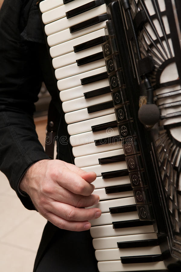 Playing the accordion stock photo