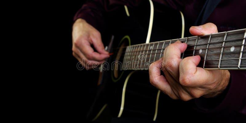 Playing an Acoustic Guitar. Closeup. Guitarist hands and guitar close up stock photos