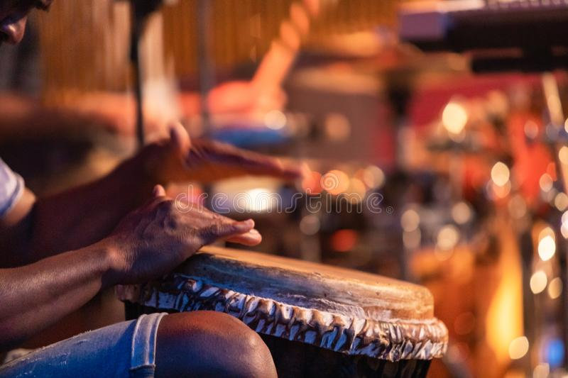 Playing a African djembe drum royalty free stock photos