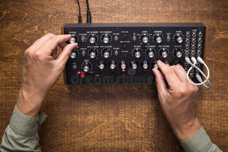 Playing on analog synthesizer royalty free stock photos