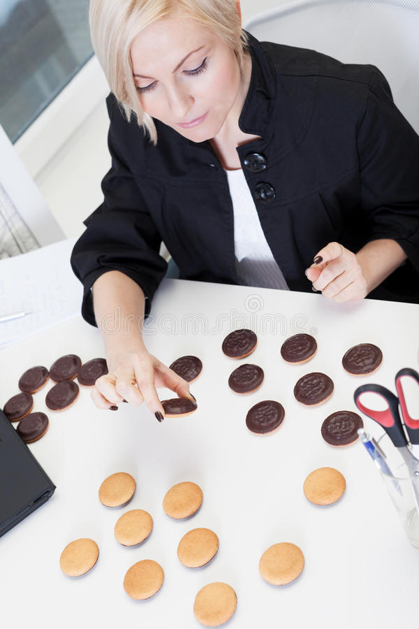Playing anti-diet game. Business woman playing anti-diet game royalty free stock image