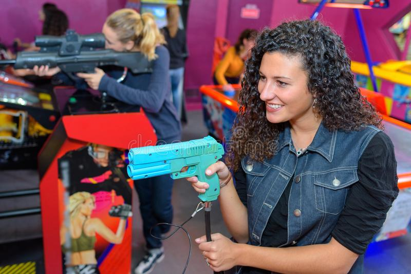 Playing at the arcade. Arcade royalty free stock images