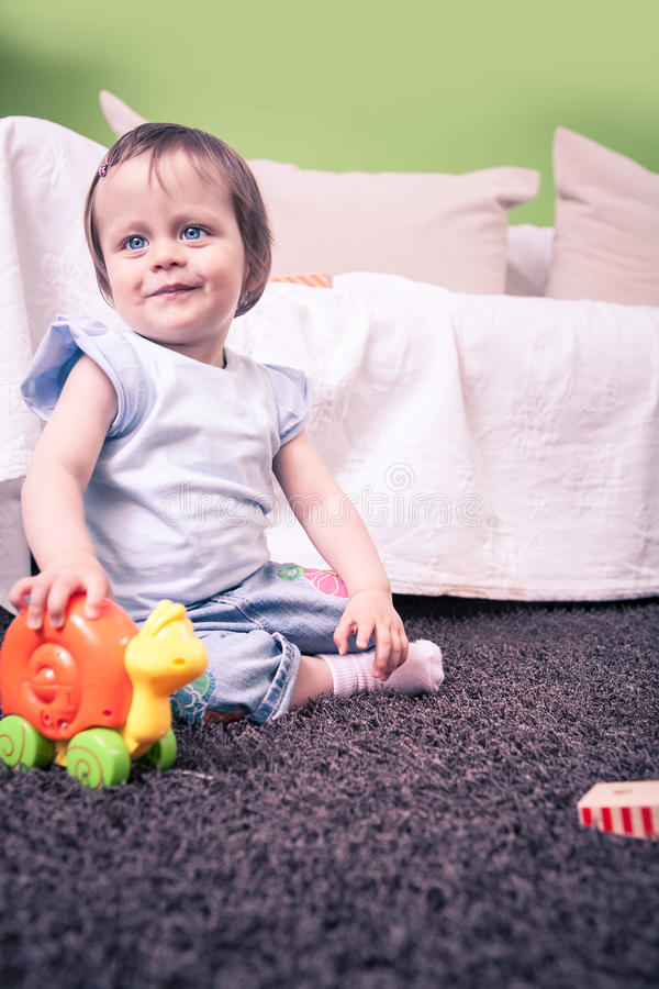 Playing baby stock photos