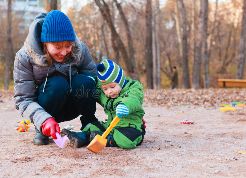 Playing with baby outdoors stock photos