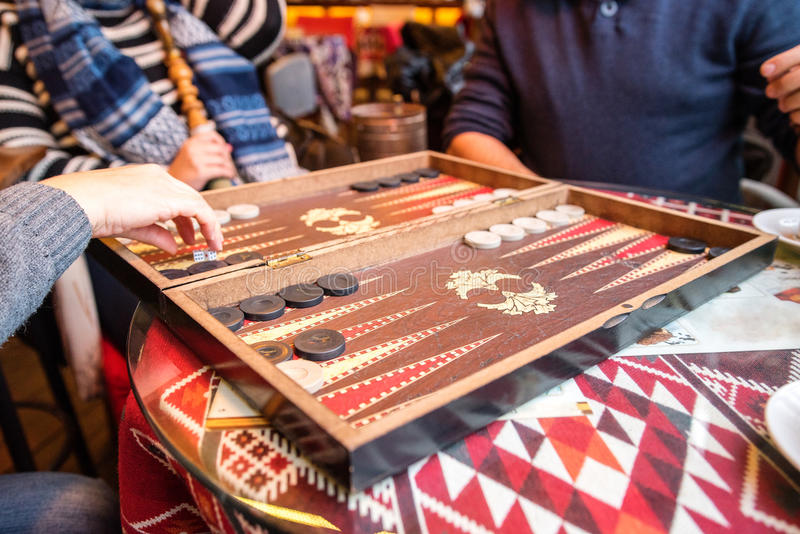 Playing Backgammon stock photo
