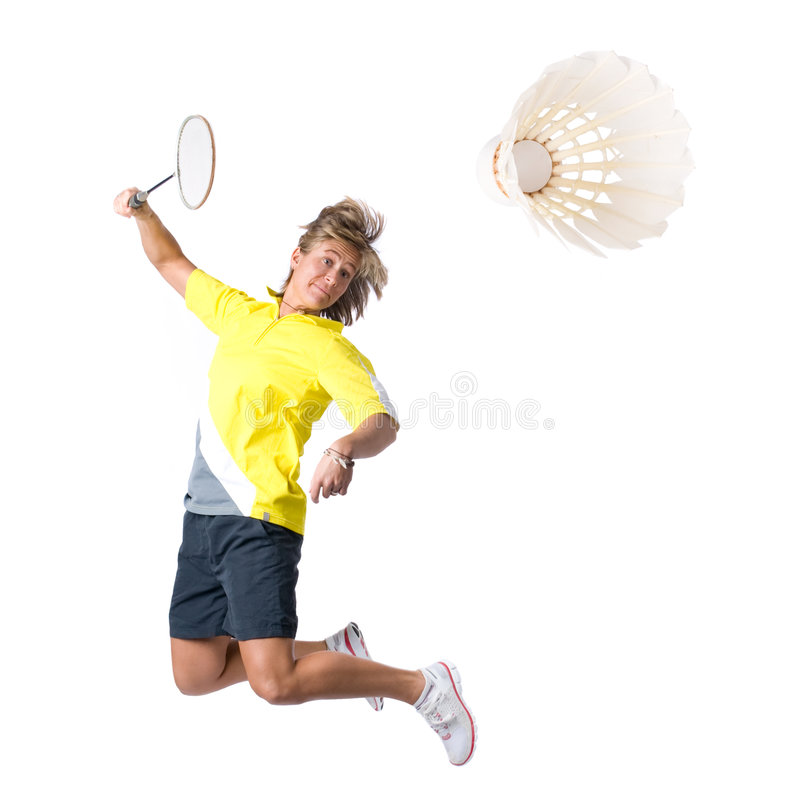 Playing badminton. Full isolated picture of a caucasian woman playing badminton stock photography