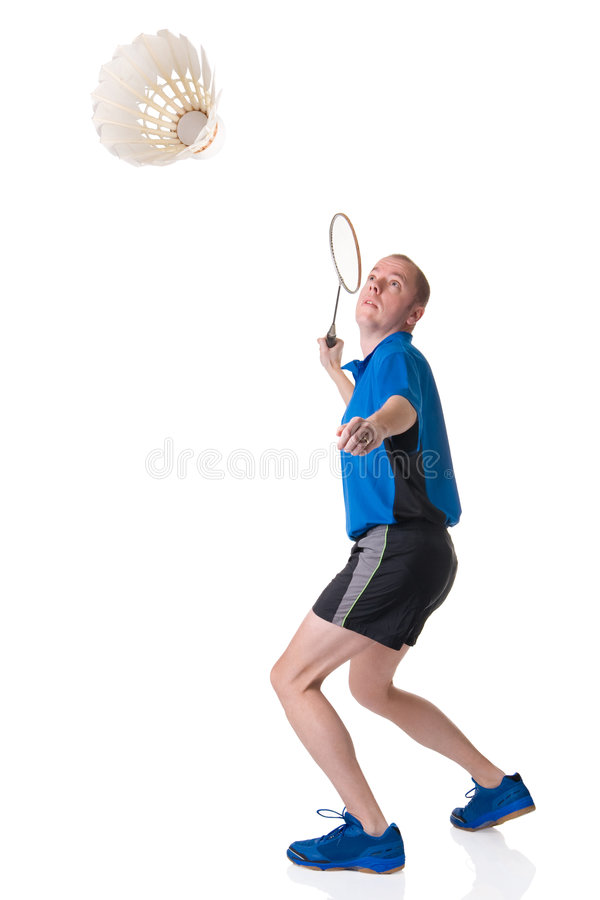 Playing badminton. Full isolated picture of a caucasian man playing badminton stock image