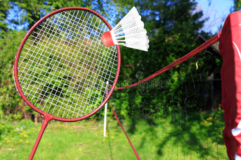 Playing badminton outdoors