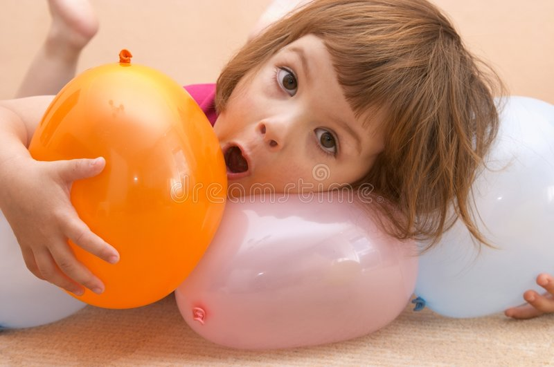 Playing with balloons royalty free stock image