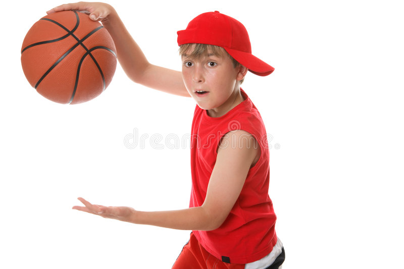 Playing basketball. A child in action playing basketball royalty free stock photography