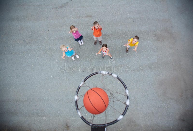 Playing basketball. Image of happy friends playing basketball on sports ground royalty free stock image