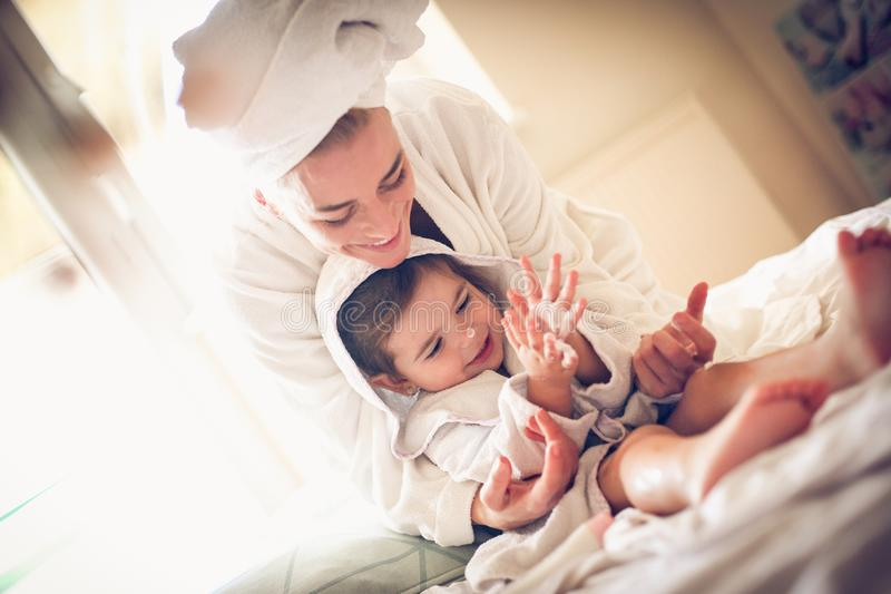 Playing after bath. Mother and daughter. royalty free stock image
