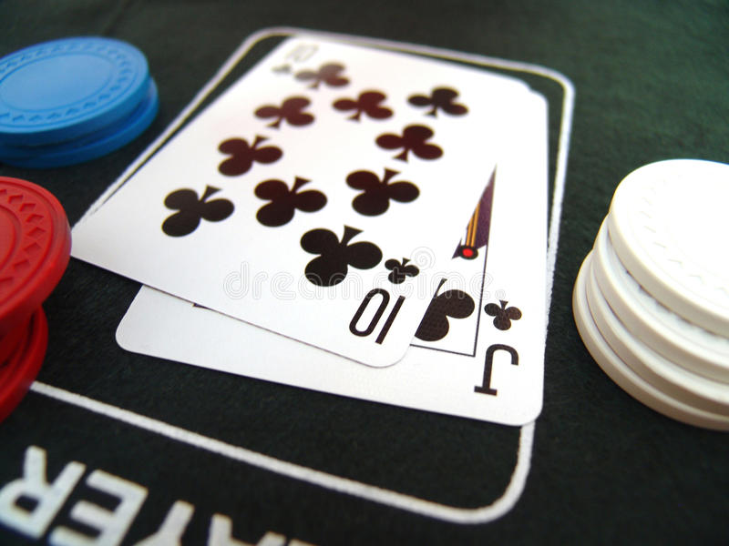 Playing card and poker chips stock photo
