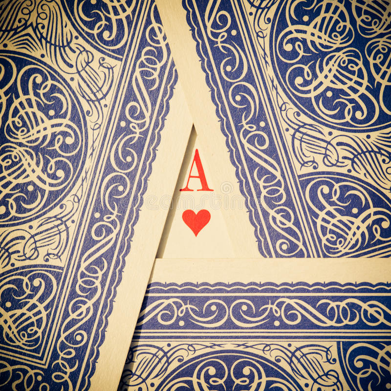 Playing cards with ace of hearts royalty free stock photography