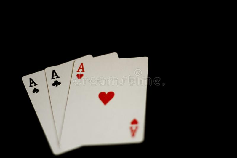 Playing cards on a black bacground royalty free stock photography