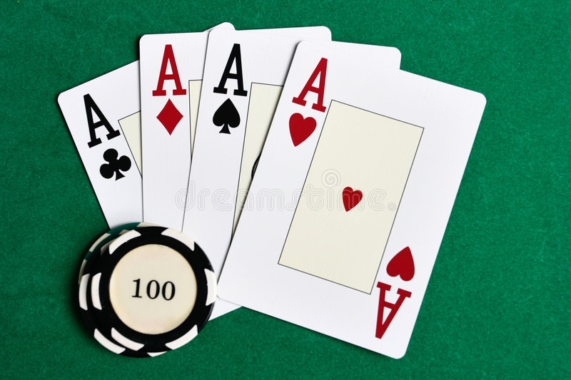 Playing cards and casino chips. Casino chips and four aces on green felt royalty free stock images