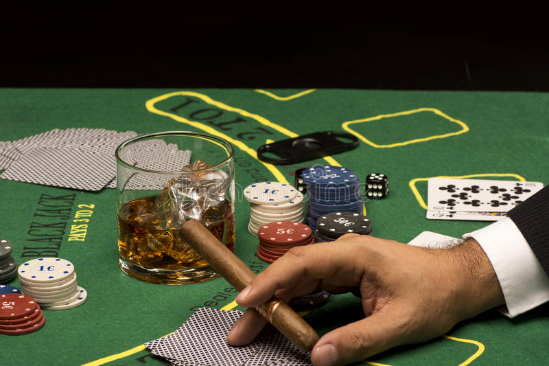 Playing cards on casino table royalty free stock image
