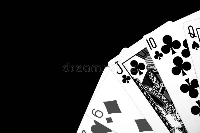 Playing cards on a dark background. Black and white royalty free stock photo
