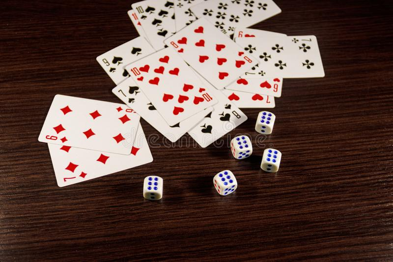 Playing cards and dice on  table. Game concept stock photo