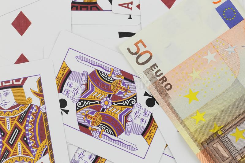 Playing cards and euro cash studio photography royalty free stock photography