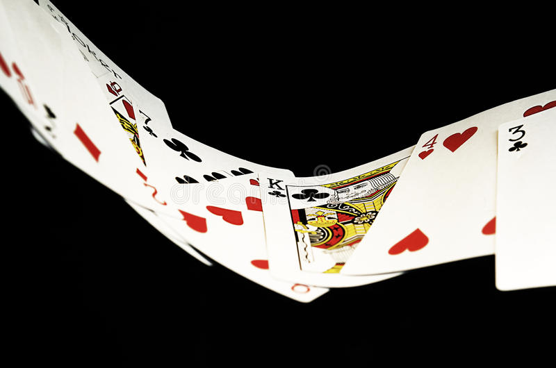 Playing cards floating in the air stock image