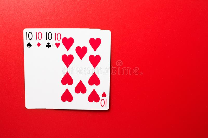 Playing cards four ten. On a red background stock photo