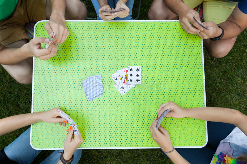Playing cards on a garden party stock photos