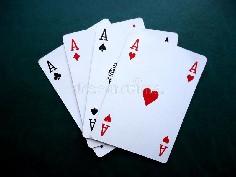 Playing cards on green background. Set of four aces. stock images