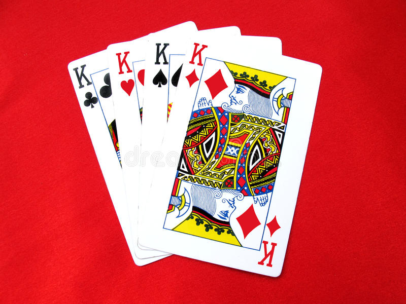Playing Cards-Kings. Four kings of playing cards isolated on white royalty free stock photos