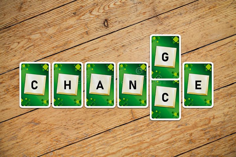 Playing cards with text `change-chance` on a wooden floor royalty free stock photos