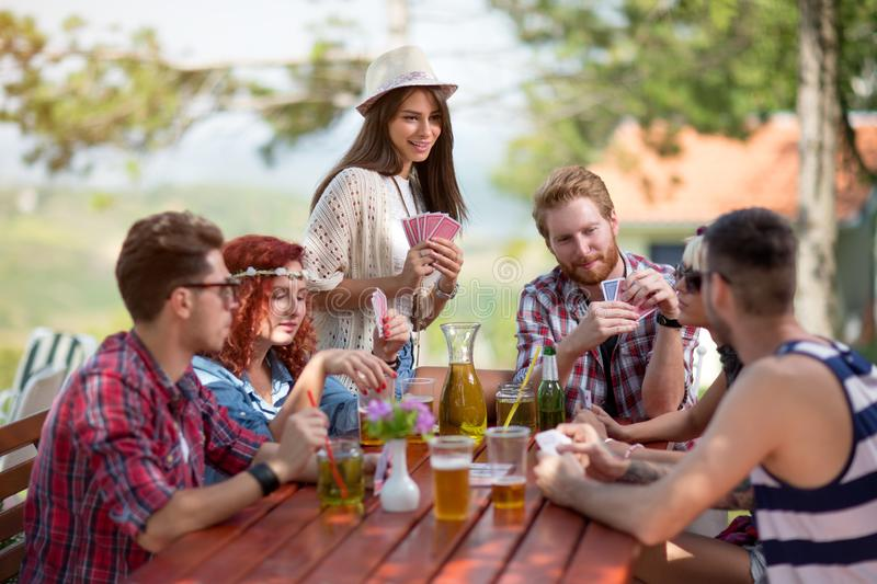 Playing cards outside in progress stock images