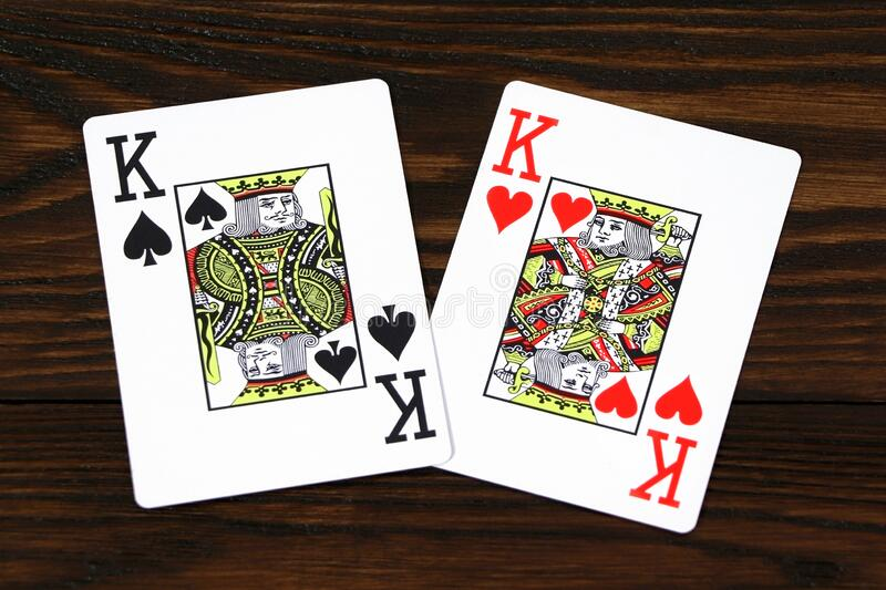 Playing cards for poker on a wooden table.  royalty free stock photos