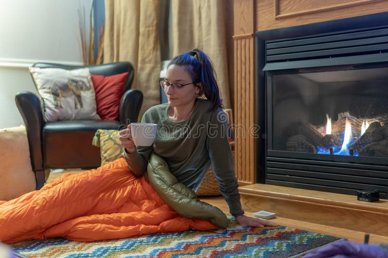 Keeping warm with down blankets by the fire stock photo
