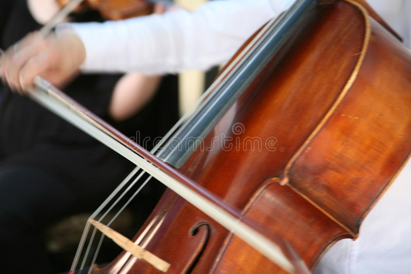 Playing cello stock images